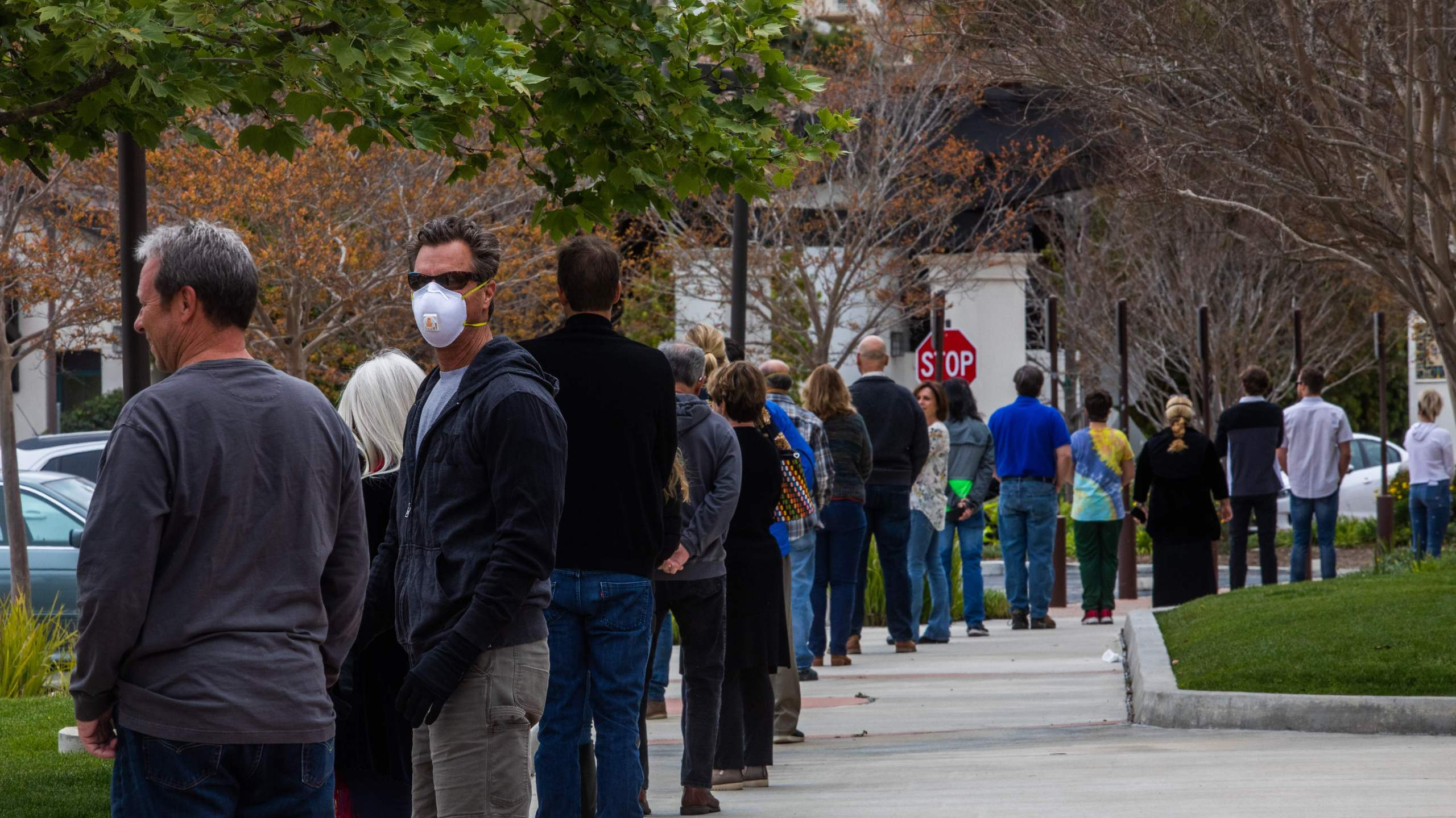 People wait in line to get into the Godspeak Calvary Chapel in Thousand Oaks to take communion after watching Palm Sunday Service on April 5, 2020. (Apu Gomes / AFP / Getty Images)