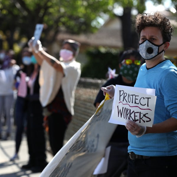 Health care workers at Alameda Hospital hold signs as they protest outside of the hospital on April 07, 2020 in Alameda. (Justin Sullivan/Getty Images)