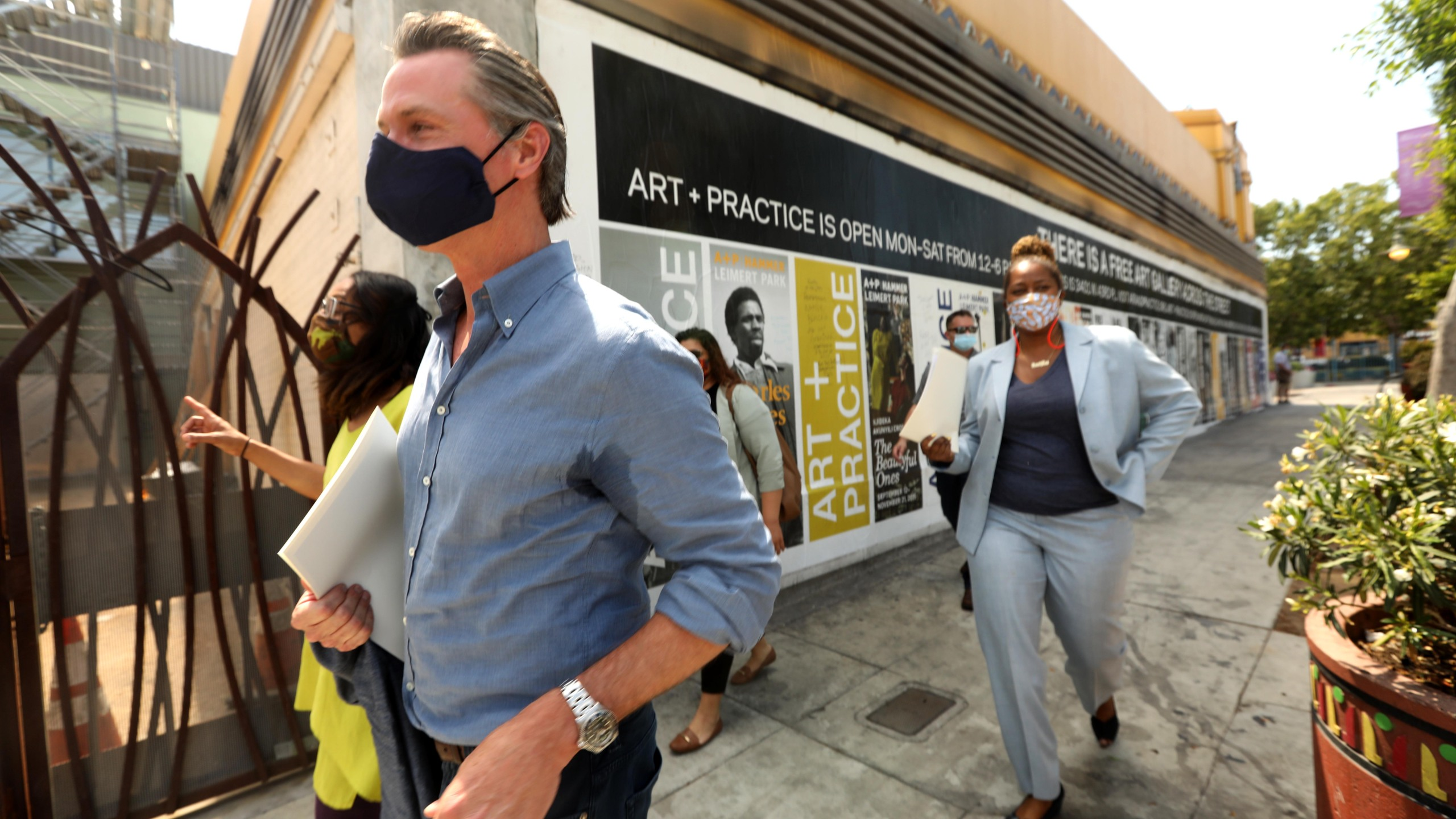 California Gov. Gavin Newsom takes a tour of businesses in Leimert Park with California Assembly Member Sydney Kamlager-Dove (L) and California Senator Holly Mitchell (R) after days of protests in Los Angeles in Leimert Park in Los Angeles on June 3, 2020, as the state opens from the coronavirus shutdown. (Genaro Molina / POOL / AFP via Getty Images)