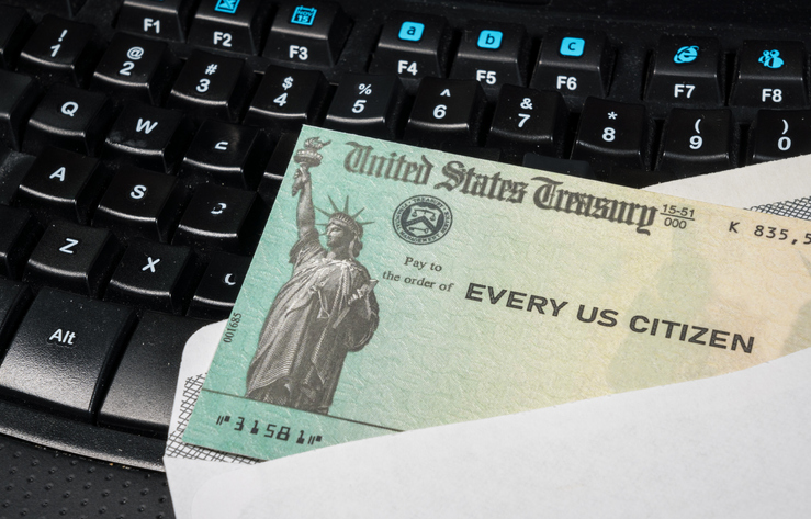 An illustration of the federal stimulus payment check from the IRS on a keyboard. (Getty Images)