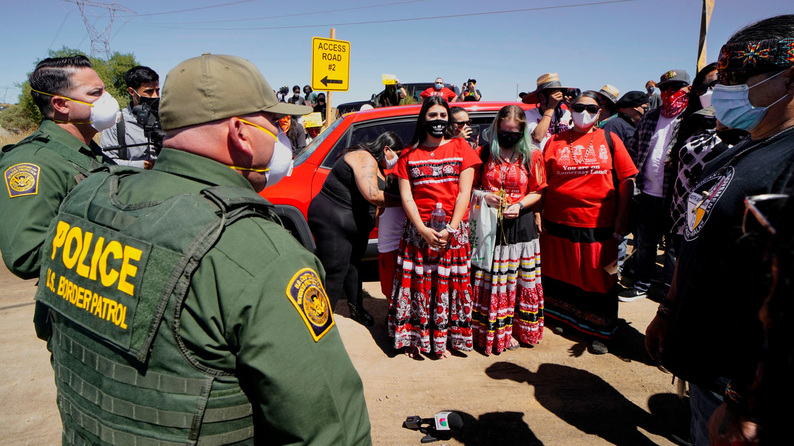 Members of the Kumeyaay band of Indians and demonstrators prepare to march to the U.S.-Mexico border to protest construction of a new wall being constructed on their ancestral grounds on July 1, 2020 in Boulevard, California. (SANDY HUFFAKER/AFP via Getty Images)