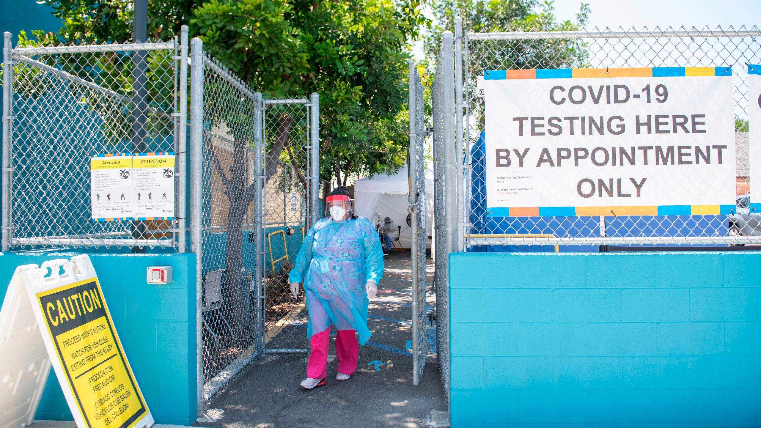 A health worker walks near a COVID-19 testing site at St. John's Well Child and Family Center, amid the novel coronavirus pandemic, July 24, 2020, in Los Angeles. (VALERIE MACON/AFP via Getty Images)