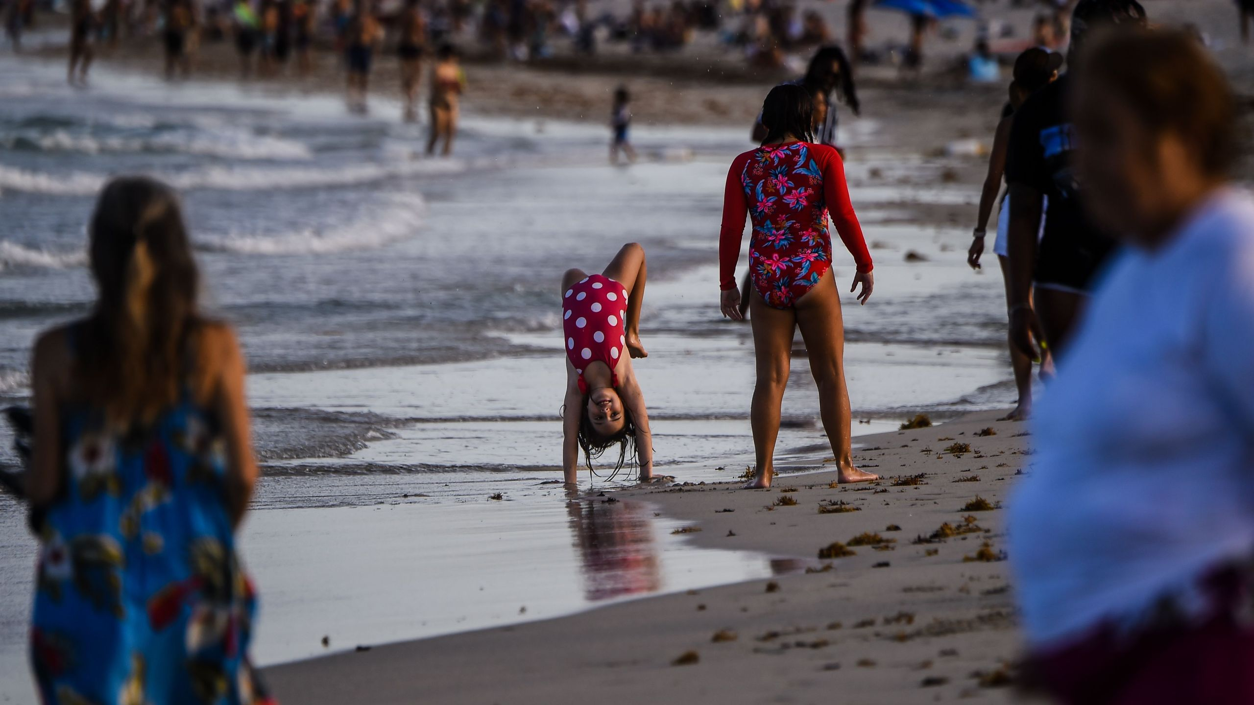 Children play on the beach in Miami Beach, Florida on July 28, 2020, amid the coronavirus pandemic. (CHANDAN KHANNA/AFP via Getty Images)