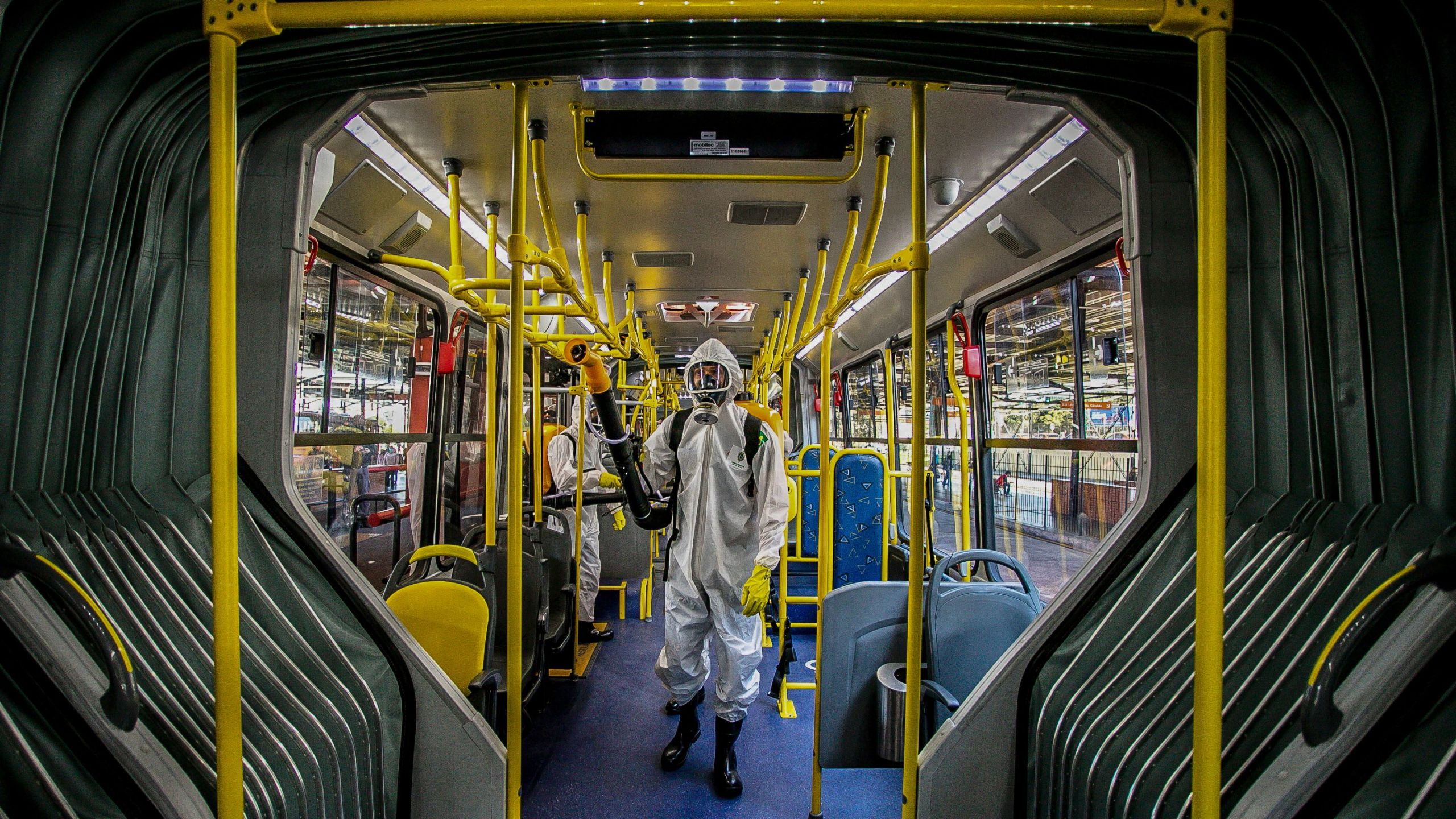 Military personnel from the Brazilian Armed Forces sanitize a bus at the Santa Candida bus terminal to combat the spread of the the novel coronavirus, COVID-19, in Curitiba, Parana State, Brazil, on August 10, 2020. (DANIEL CASTELLANO/AFP via Getty Images)