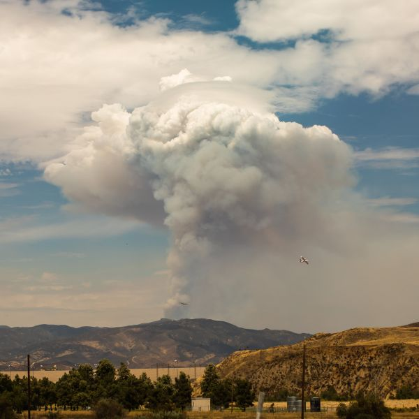 A plume of smoke from the Lake Fire in the Angeles National Forest is seen from Castaic, California on Aug. 13, 2020. (APU GOMES/AFP via Getty Images)