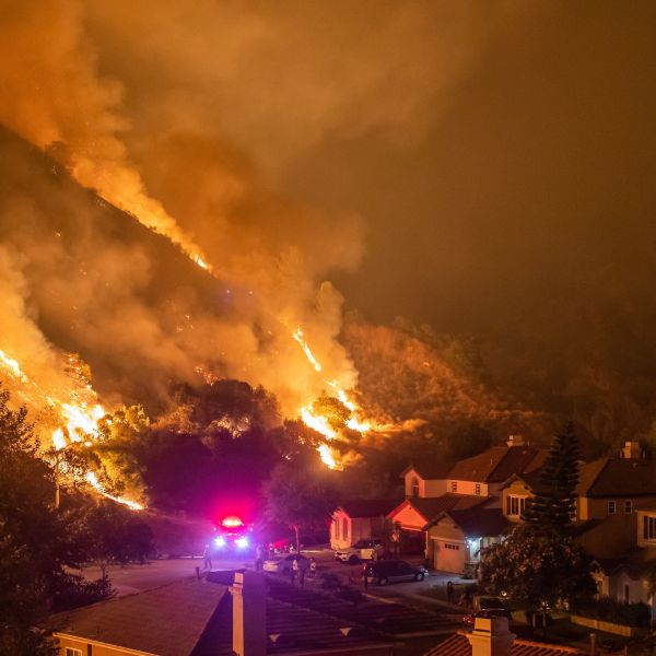 Firefighters battle the smoke and flames from the Ranch 2 Fire in the hills in Azusa on Aug. 14, 2020. (Apu Gomes / AFP / Getty Images)