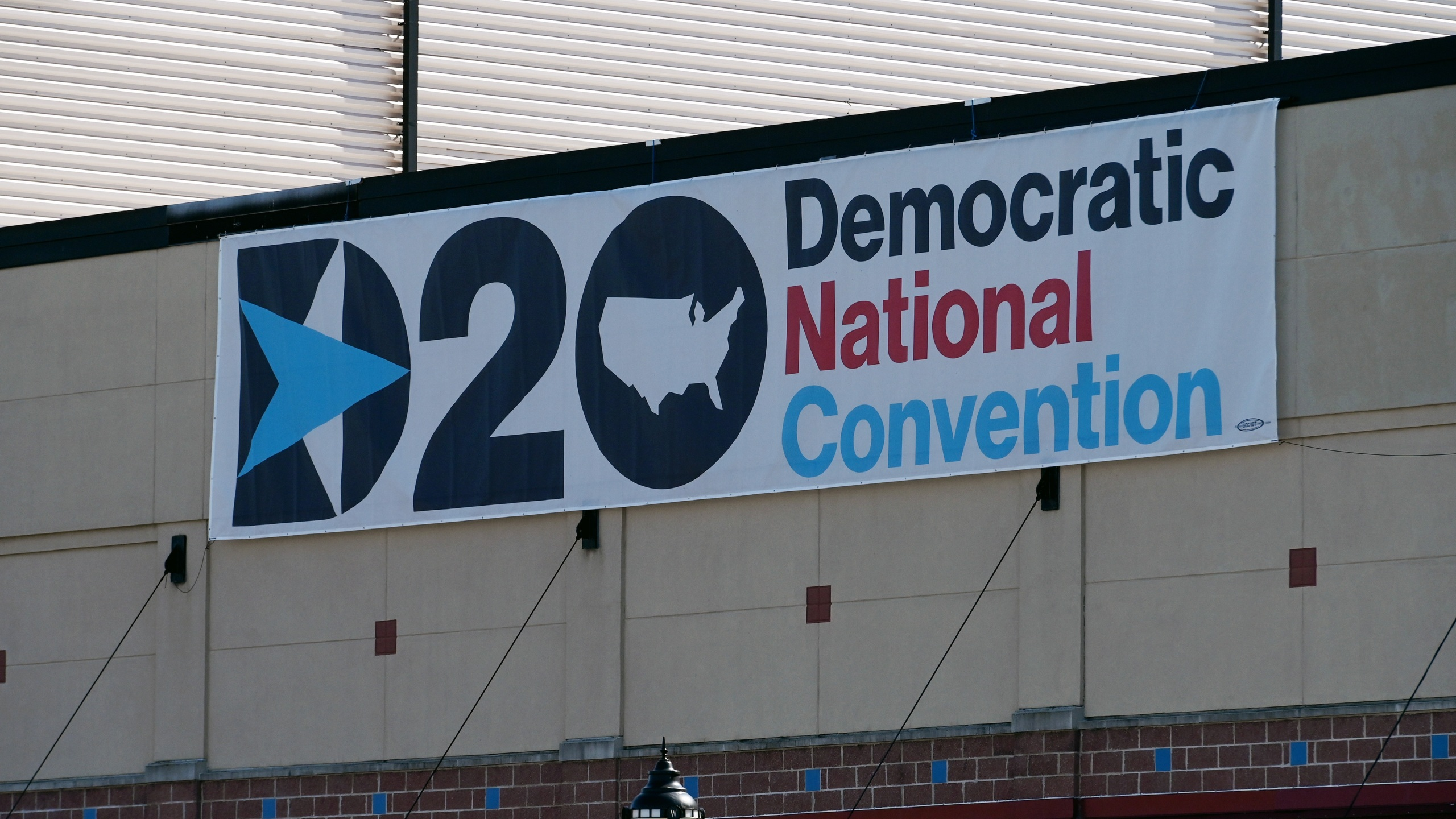 A banner is seen on the second day of the Democratic National Convention at the Chase Center in Wilmington, Delaware on Aug. 18, 2020. (OLIVIER DOULIERY/AFP via Getty Images)