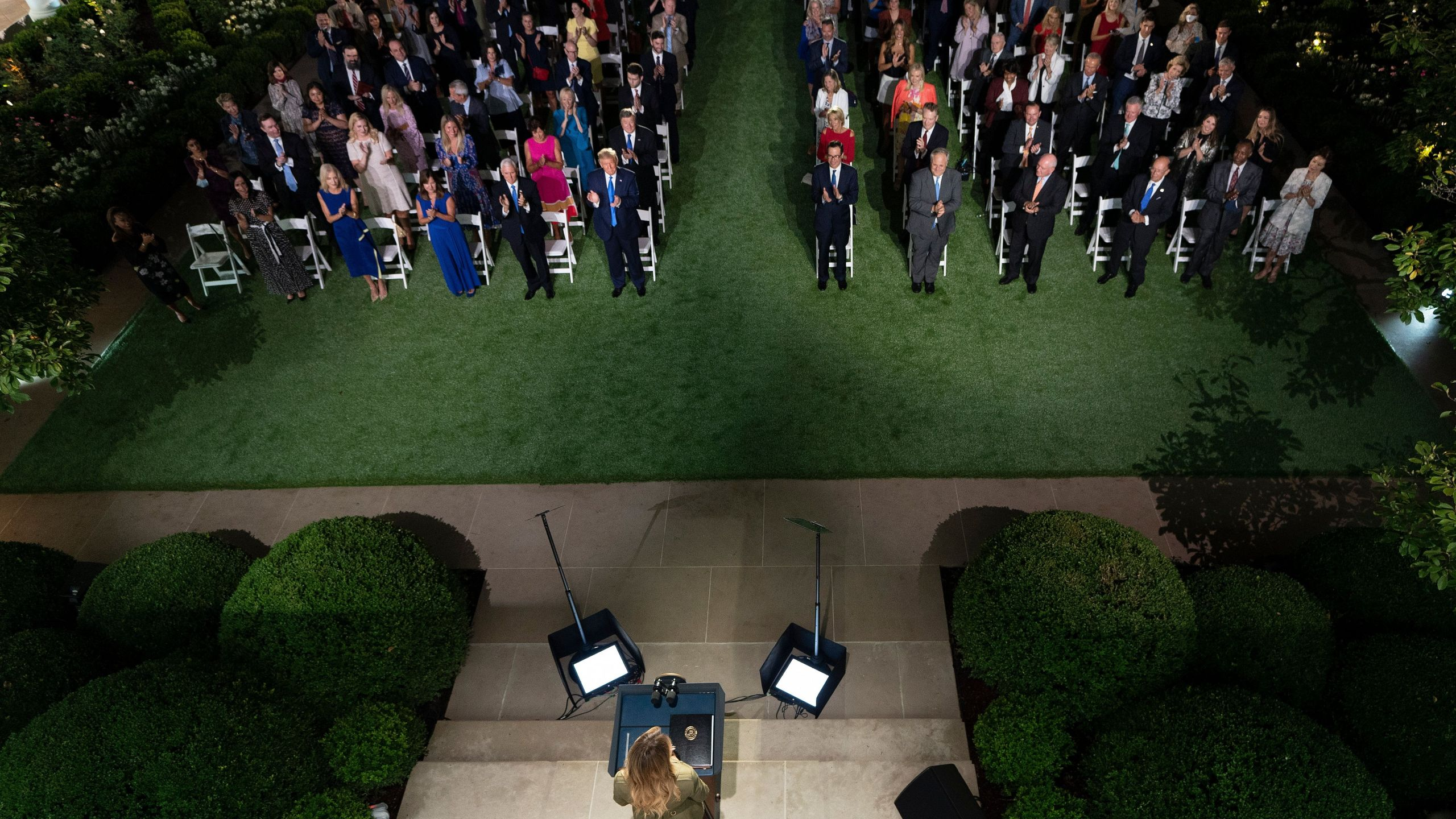 President Donald Trump along with Vice President Mike Pence and Second Lady Karen Pence applaud first lady Melania Trump as she arrives to address the Republican Convention during its second day from the Rose Garden of the White House on Aug. 25, 2020. (BRENDAN SMIALOWSKI/AFP via Getty Images)