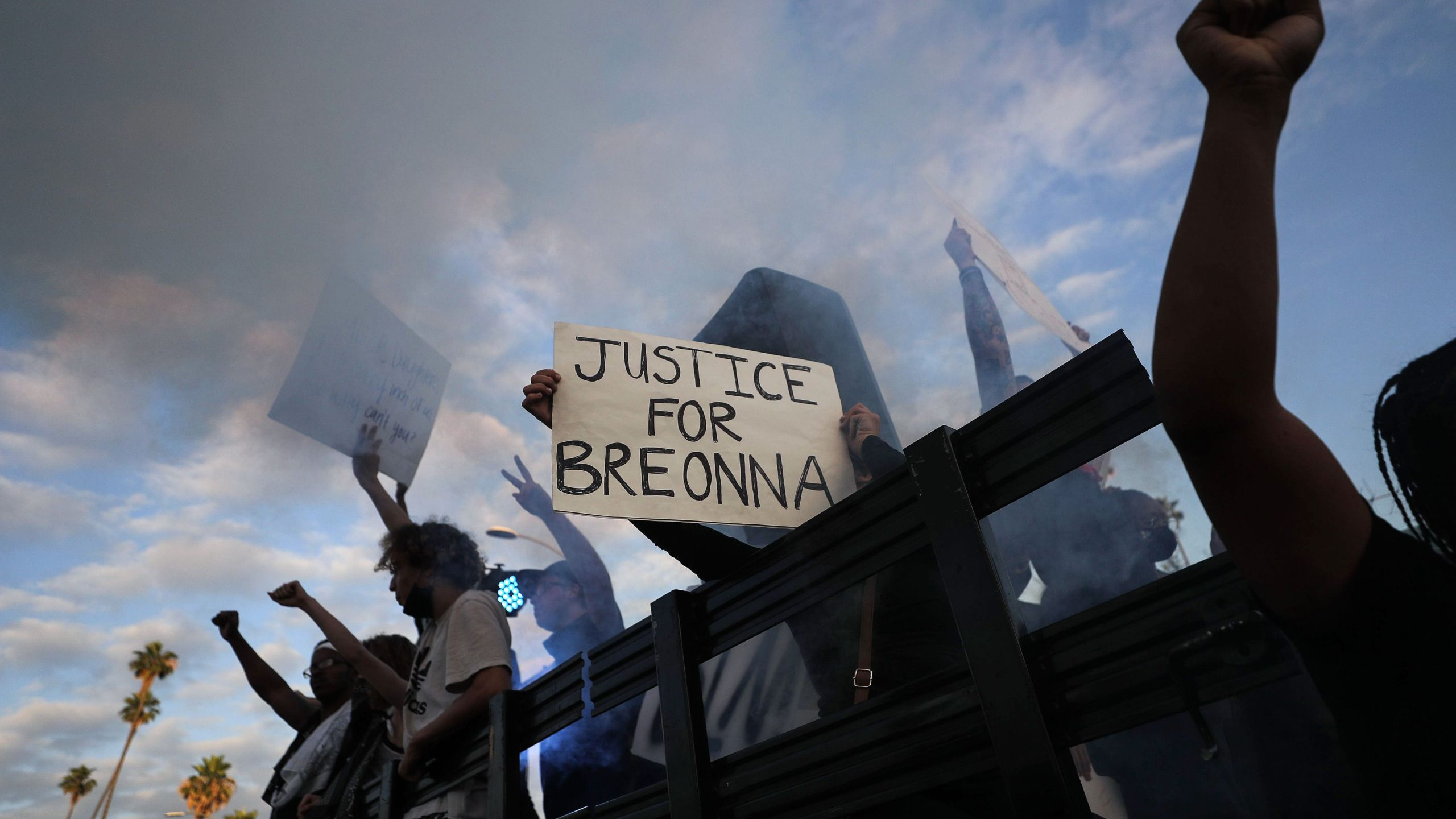 "Protesters ride aboard a vehicle with a smoke machine, with a sign reading ""Justice for Breonna,"" during a demonstration against racism and police brutality on Hollywood Boulevard on June 6, 2020. (Mario Tama/Getty Images)"