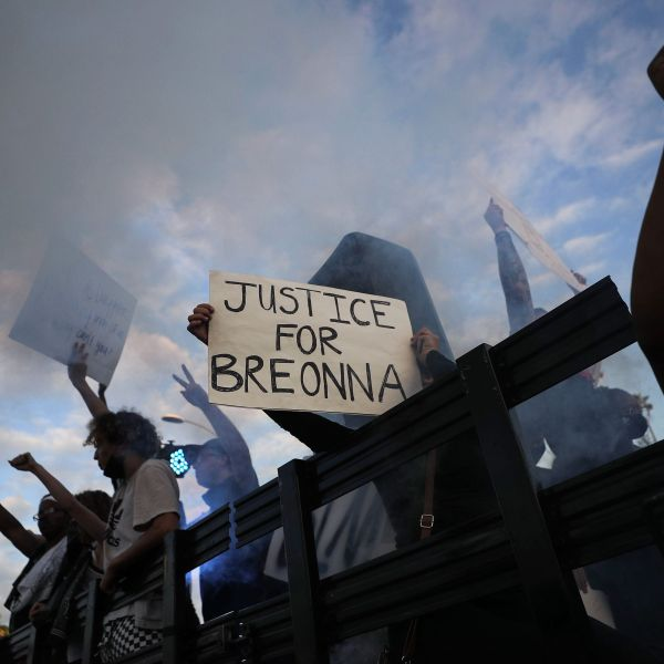 """Protesters ride aboard a vehicle with a smoke machine, with a sign reading """"Justice for Breonna,"""" during a demonstration against racism and police brutality on Hollywood Boulevard on June 6, 2020. (Mario Tama/Getty Images)"""