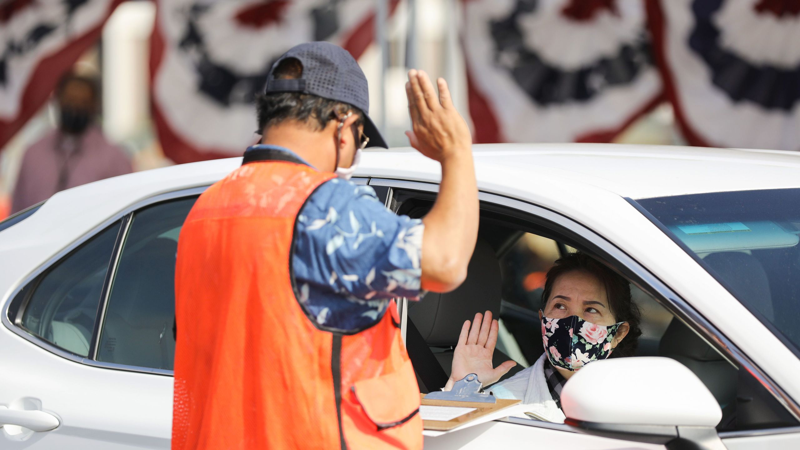 A woman is sworn in as a new U.S. citizen from inside a vehicle at a drive-in naturalization ceremony conducted amid the COVID-19 pandemic on July 29, 2020 in Santa Ana. (Mario Tama/Getty Images)