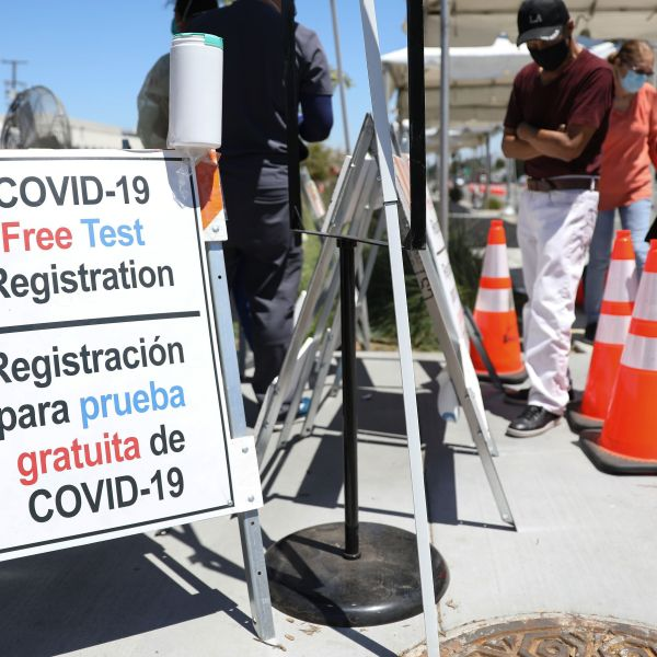 A sign at a COVID-19 testing center is written in English and Spanish amid the coronavirus pandemic on July 31, 2020 in Los Angeles. (Mario Tama/Getty Images)