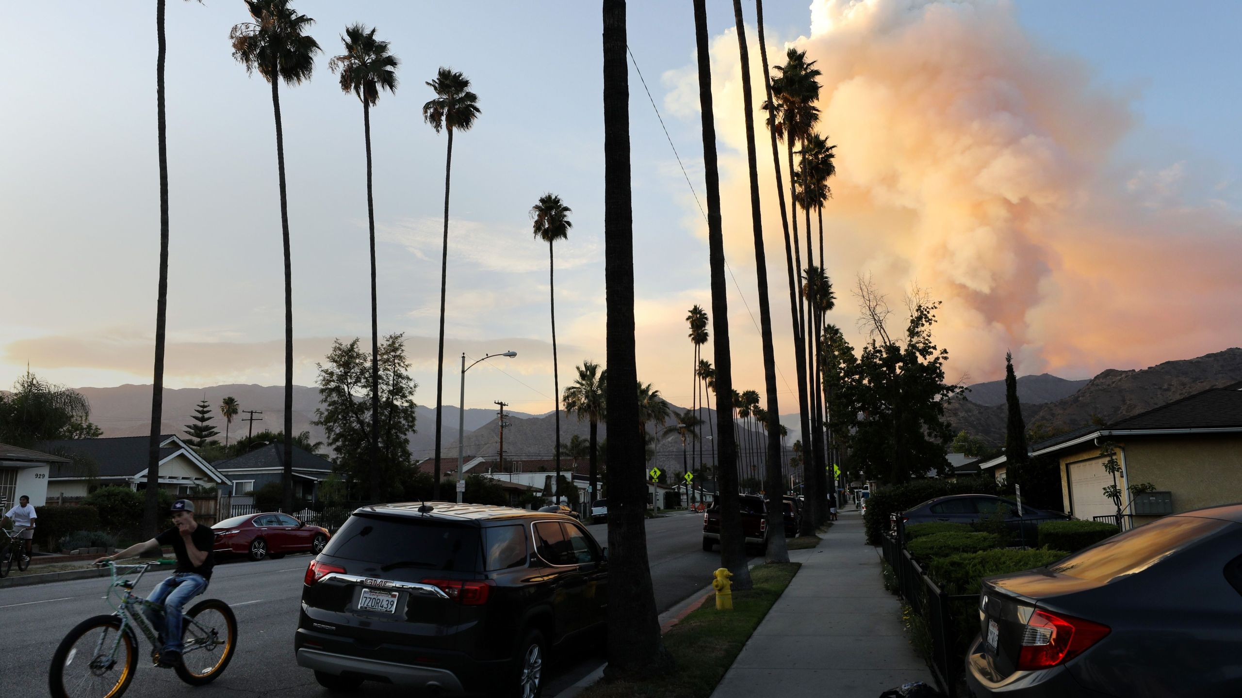 A plume of smoke rises from the Ranch 2 Fire on Aug. 15, 2020 in Azusa. (Mario Tama/Getty Images)