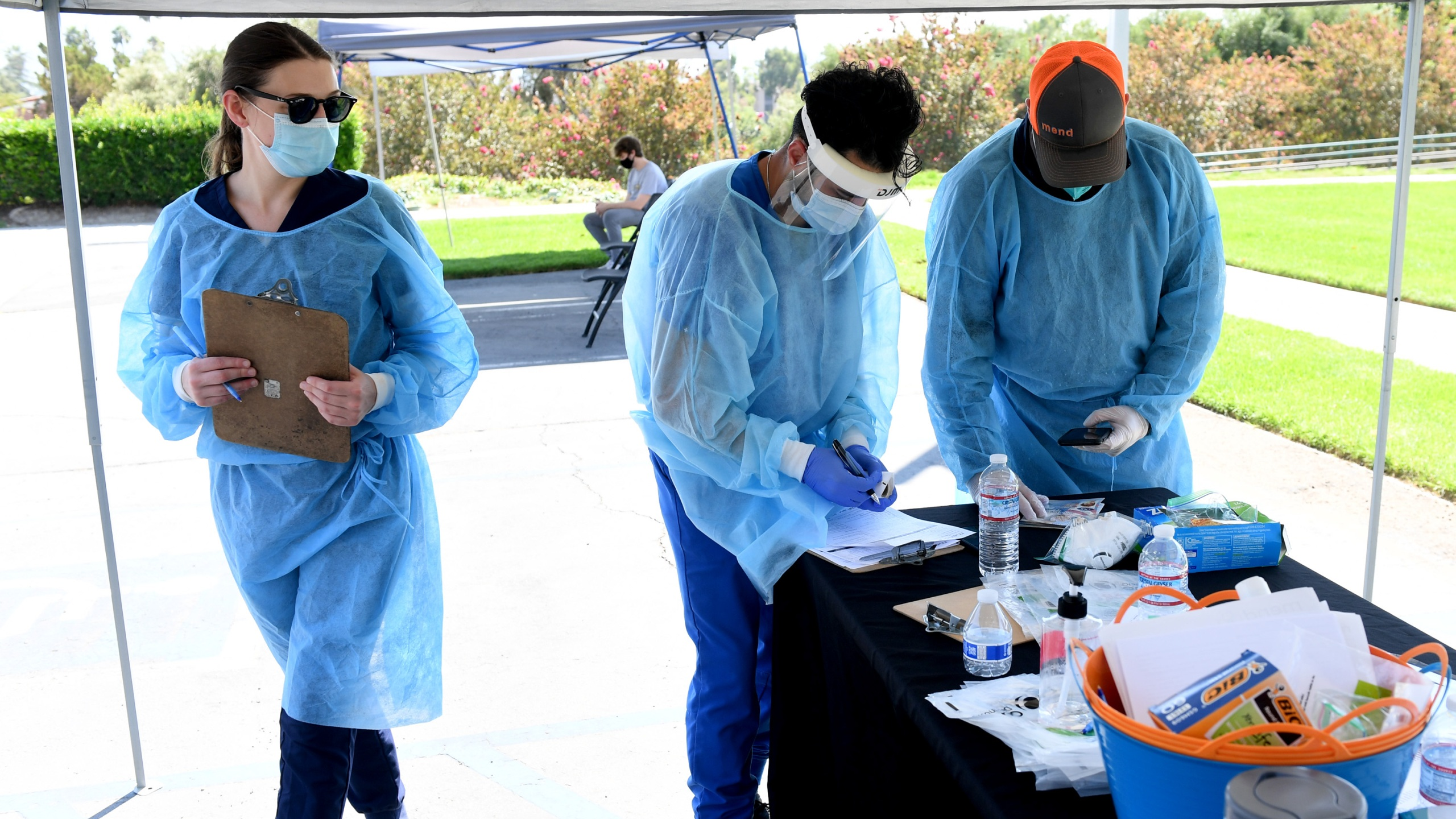 Mend Urgent Care workers wearing personal protective equipment perform drive-up COVID-19 testing for students and faculty on the first day of school at Woodbury University in Burbank on Aug. 24, 2020. (Kevin Winter/Getty Images)