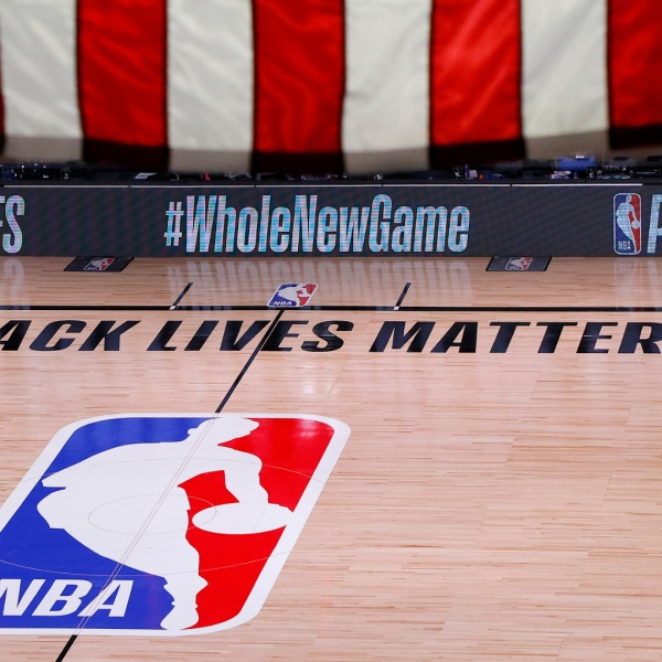 An empty court and bench is shown following the scheduled start time in Game Five of the Eastern Conference First Round between the Milwaukee Bucks and the Orlando Magic during the 2020 NBA Playoffs at AdventHealth Arena in Lake Buena Vista, Florida, on Aug. 26, 2020. (Kevin C. Cox/Getty Images)
