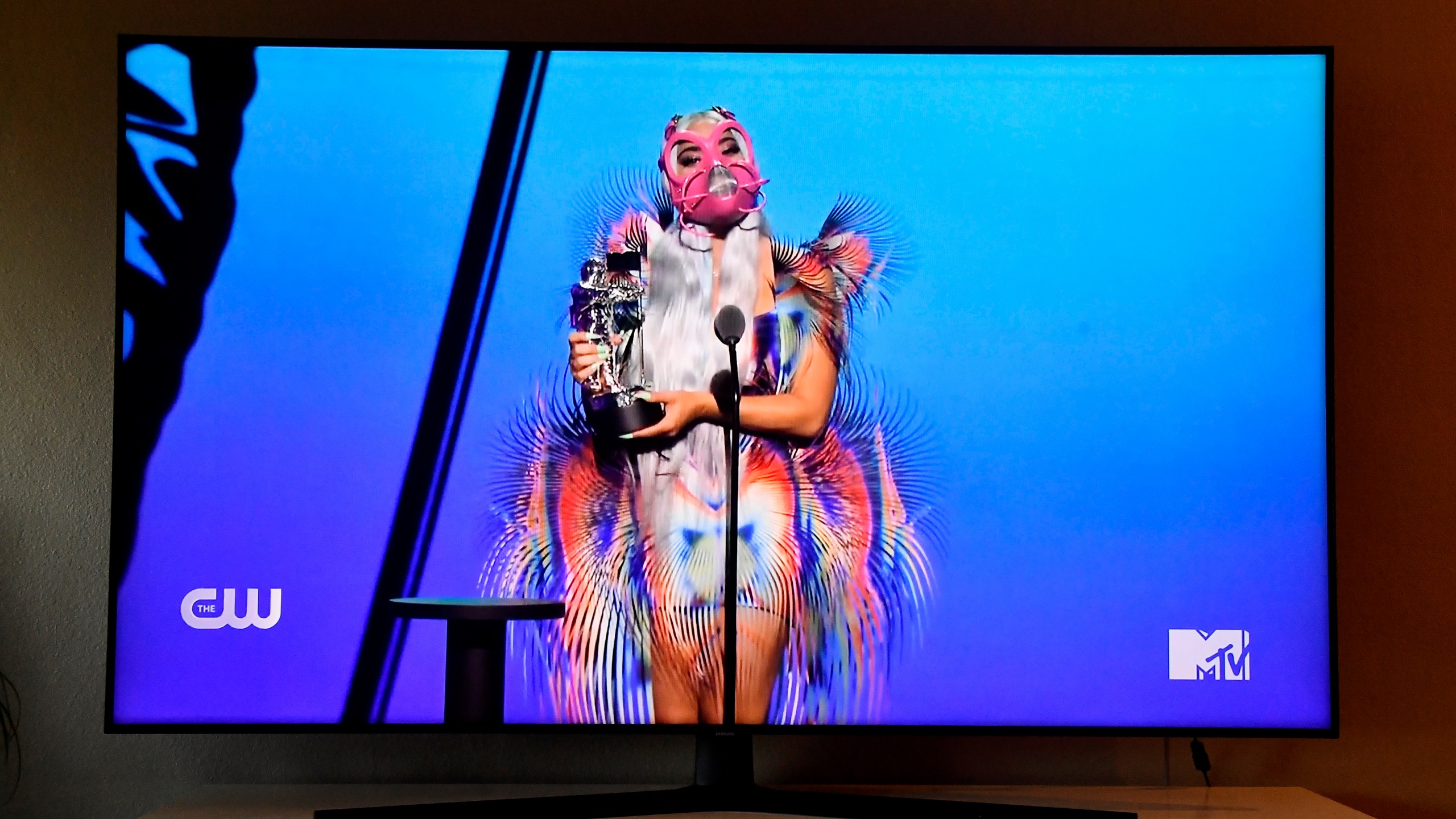 """In this photo illustration, Lady Gaga accepts the Best Collaboration award for """"Rain on Me"""" with Ariana Grande, viewed on a television screen, during the 2020 MTV Video Music Awards broadcast on Aug. 30, 2020 in New York City. (Frazer Harrison/Getty Images)"""