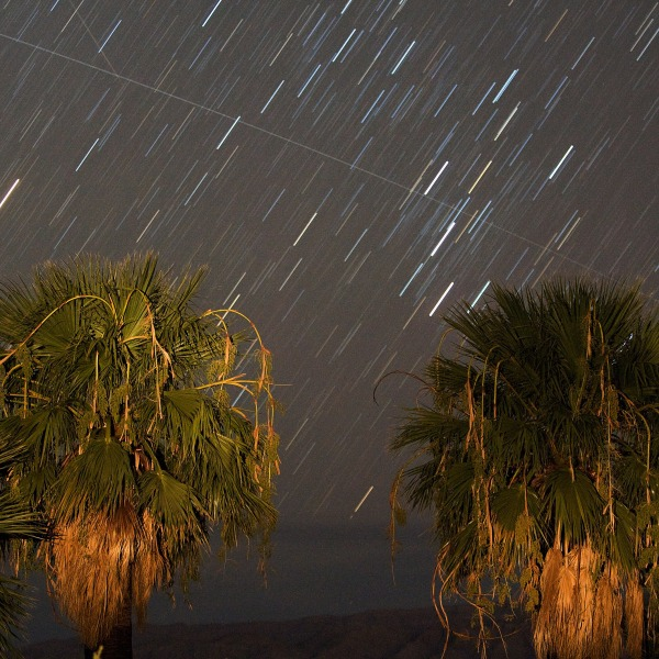 Perseid meteors fall as a satellite passes across the sky early August 12, 2008 near Rogers Spring in the Lake Mead National Recreation Area, Nevada. (Ethan Miller/Getty Images)