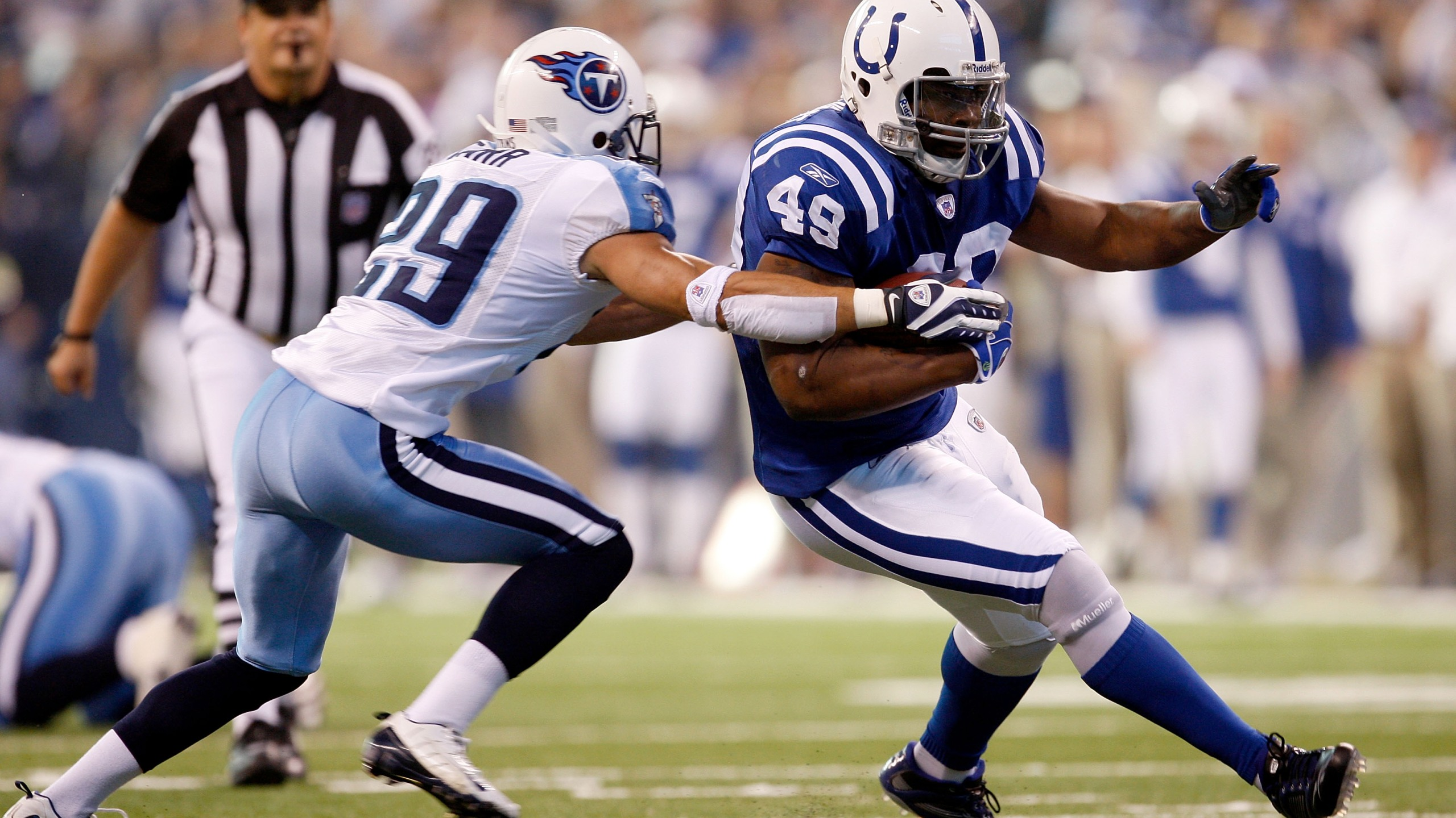 Najeh Davenport, No. 49, of the Indianapolis Colts carries the ball as Chris Carr, No. 29, of the Tennessee Titans defends during the game at Lucas Oil Stadium Dec. 28, 2008 in Indianapolis, Indiana. (Jamie Squire/Getty Images)