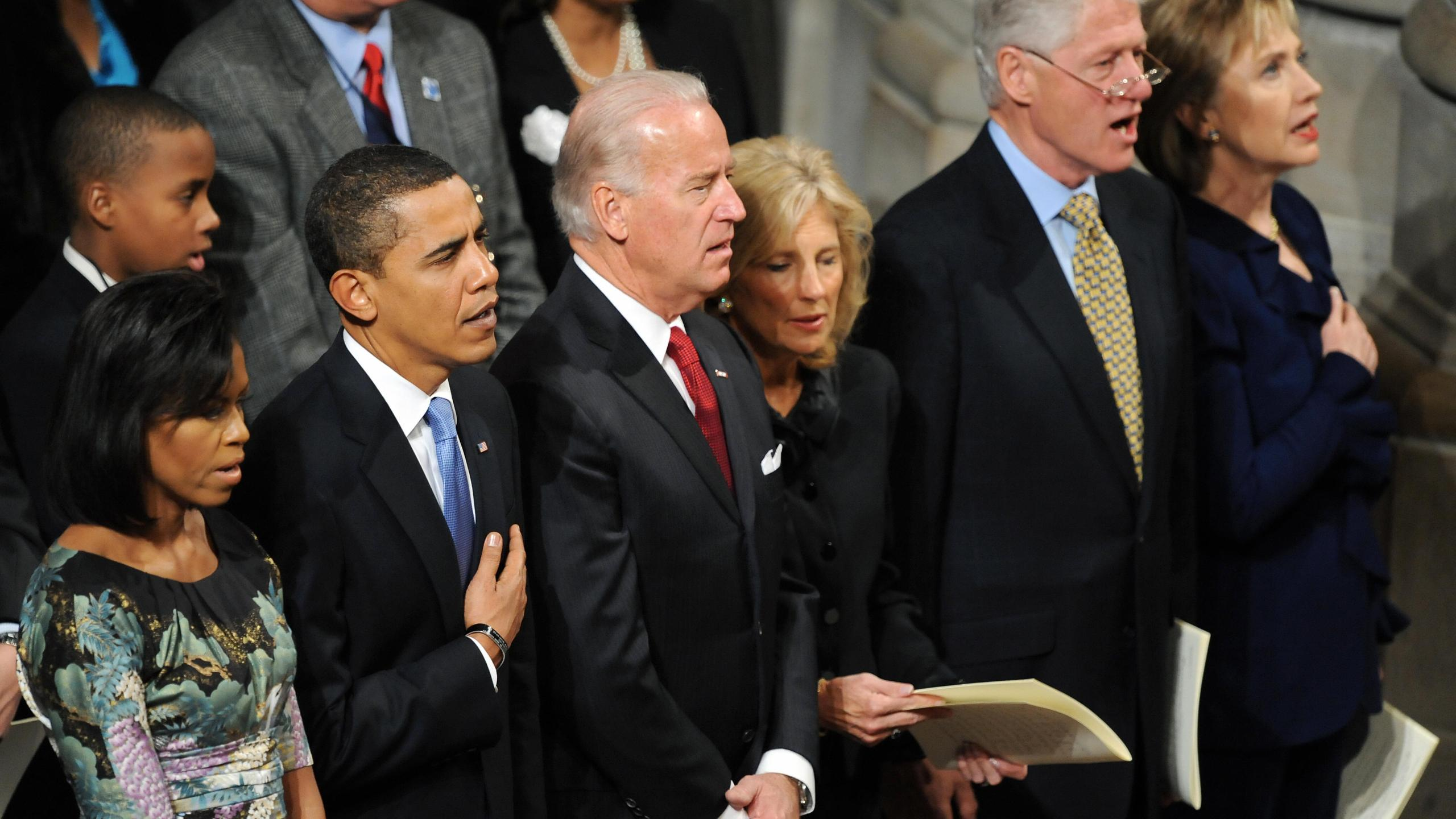 Barack and Michella Obama, Joe and Jill Biden, and Bill and Hillary Rodham Clinton attend the National Prayer Service in Washington, D.C., on Jan. 21, 2009. (JEWEL SAMAD/AFP via Getty Images)