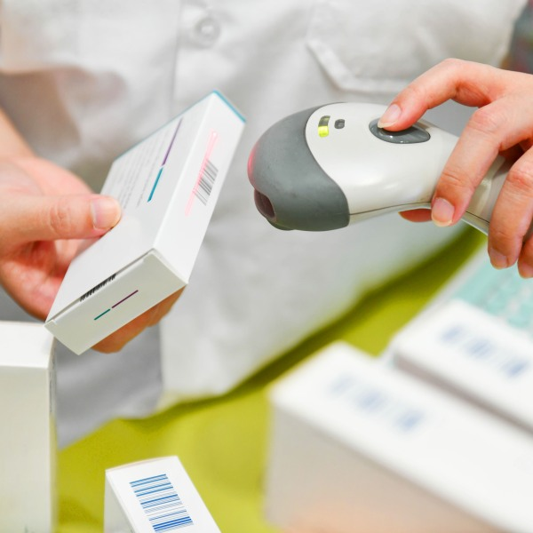 A pharmacist scans the barcode of a drug at a pharmacy. (Getty Images)
