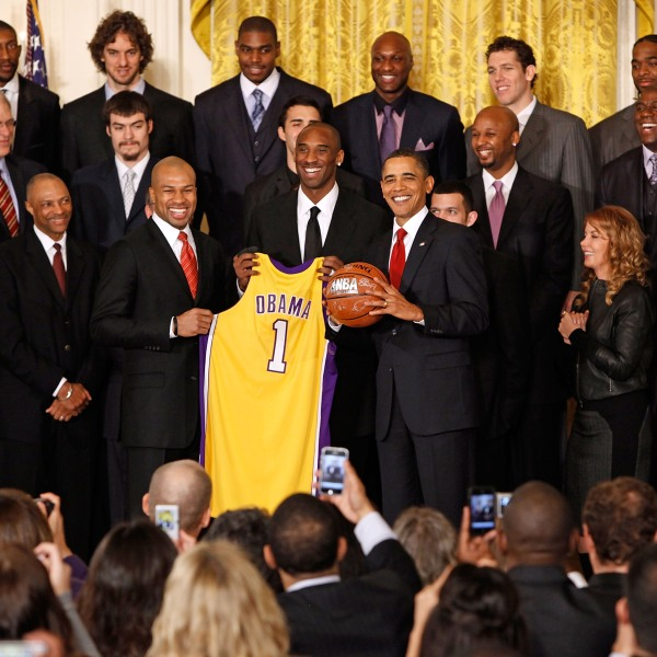 President Barack Obama poses for photographs with the National Basketball Association 2009 champions Los Angeles Lakers in the East Room of the White House on January 25, 2010, in Washington, D.C. (Chip Somodevilla/Getty Images)