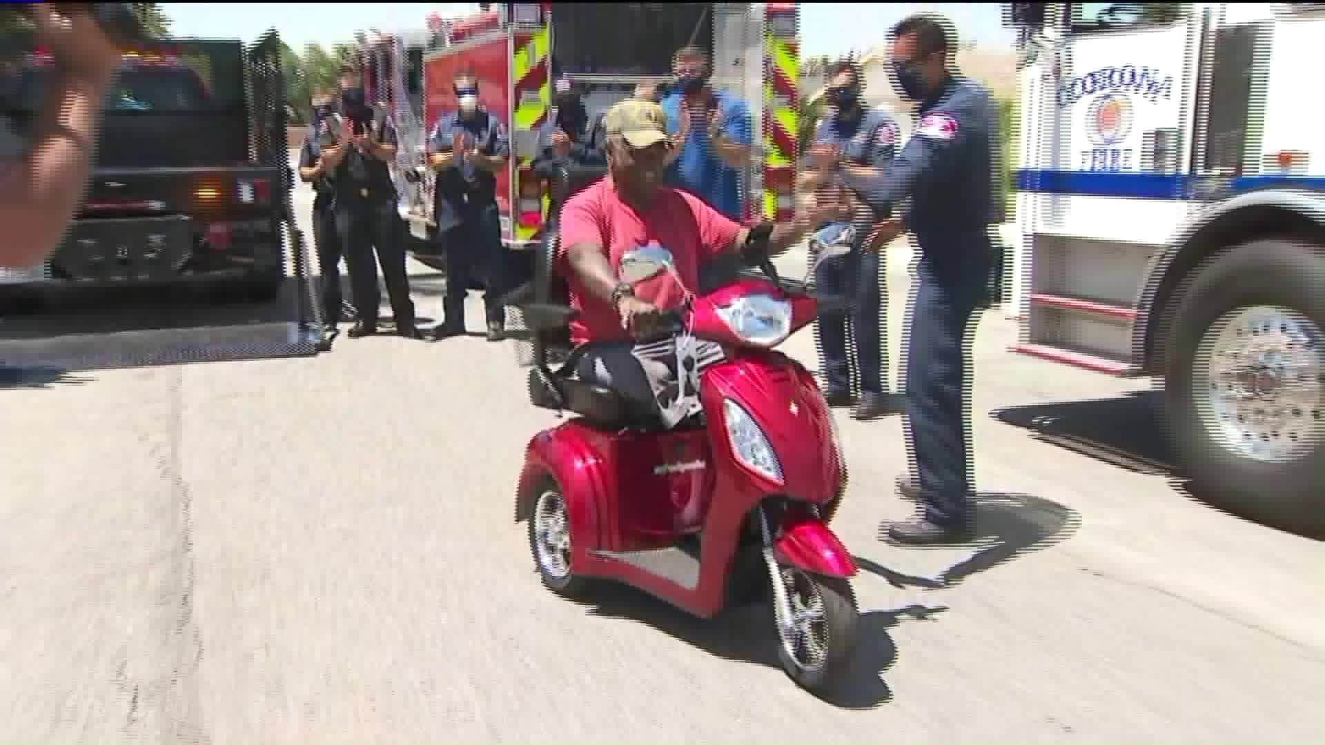 Horace Jackson receives his new electric scooter on Aug. 6, 2020. (KTLA)