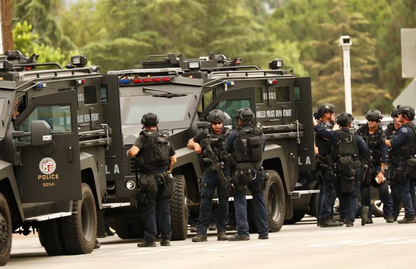 LAPD SWAT officers muster during a search for a murder suspect in Van Nuys in 2019. (Al Seib / Los Angeles Times)