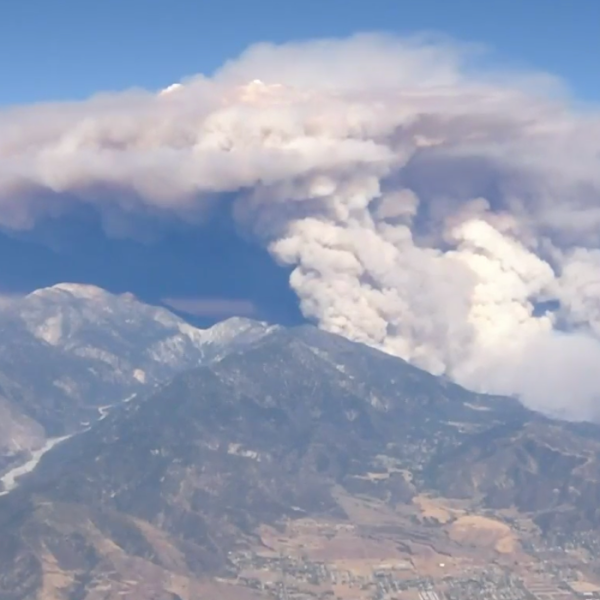The Apple Fire burns through Cherry Valley on the afternoon of Aug. 1, 2020, after scorching more than 6 square miles. It erupted in the Riverside County community the night before. (KTLA)