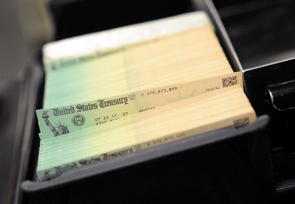 U.S. Treasury checks are piled at the U.S. Treasury printing facility. (Photo Illustration by William Thomas Cain/Getty Images)