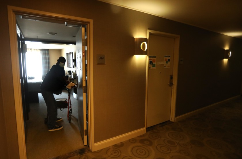 David William, 63, returns to his room at a Project Roomkey hotel in Los Angeles. (Genaro Molina / Los Angeles Times)