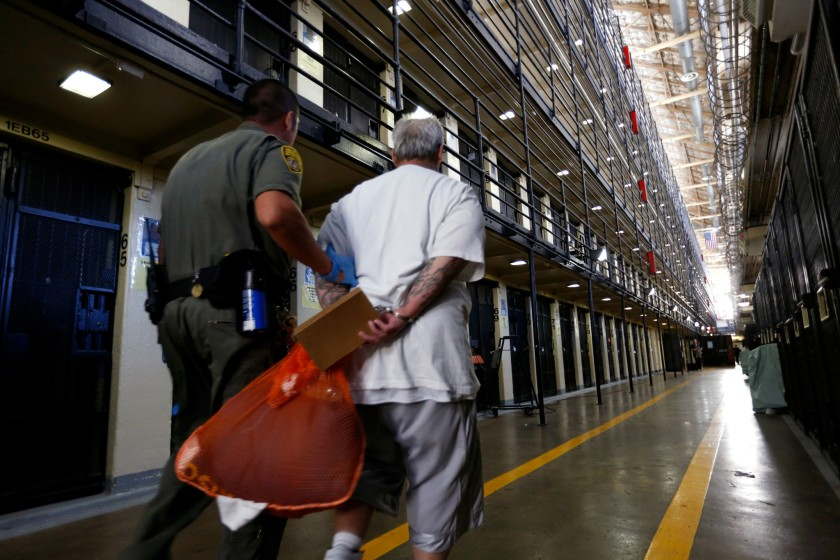 A death row inmate is escorted back to his cell after spending time in the yard at San Quentin State Prison.(Gary Coronado / Los Angeles Times)