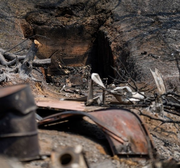 Burned-out wreckage lies at a property along California 128 where the LNU Lightning Complex fire tore through last week.(Kent Nishimura / Los Angeles Times)