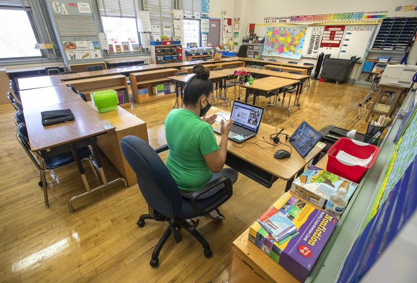 Manchester Ave. Elementary School 5th grade teacher Gladys Alvarez talks to her students during a virtual zoom class inside her empty classroom.(Mel Melcon / Los Angeles Times)