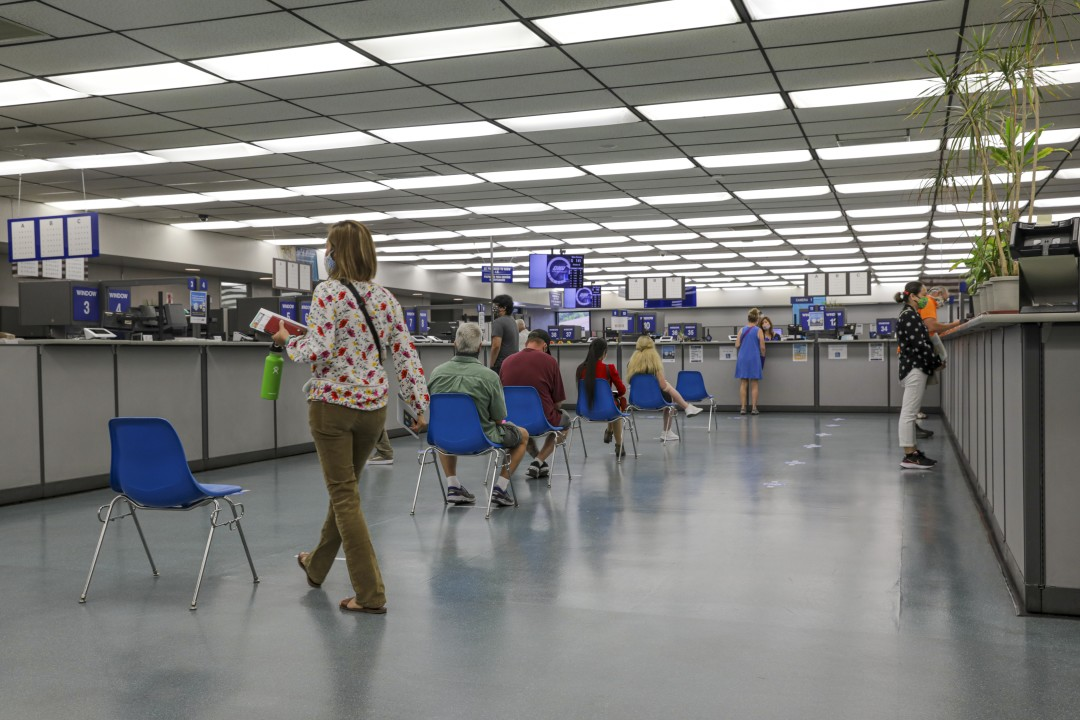 Clients stay 6 feet apart while waiting for their turn at a DMV office in Westminster in August 2020. (Irfan Khan / Los Angeles Times)
