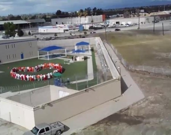 Hunger strikers at Mesa Verde ICE Processing Center in Bakersfield were captured by drone during a sit-in protest on April 10, 2020.(California Committee for Immigrant Liberation)