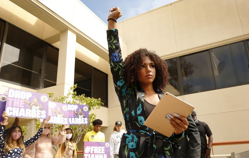 Activist Tianna Arata, 20, stands on the steps of the San Luis Obispo County courthouse Aug. 25, 2020, as supporters gather to protest her arrest after a July antiracism rally in San Luis Obispo. (Al Seib / Los Angeles Times)