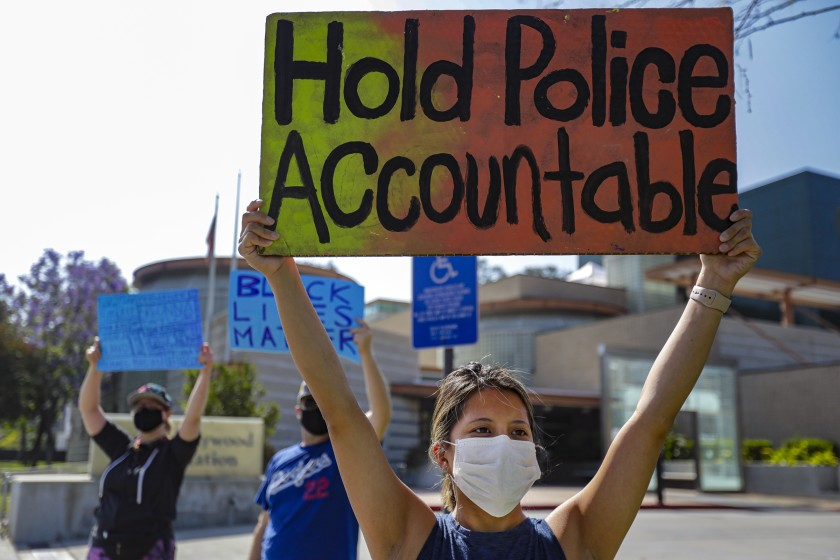 A protest over police brutality and the death of George Floyd takes place in front of North Hollywood Police Station in June, 2020. (Irfan Khan/Los Angeles Times)