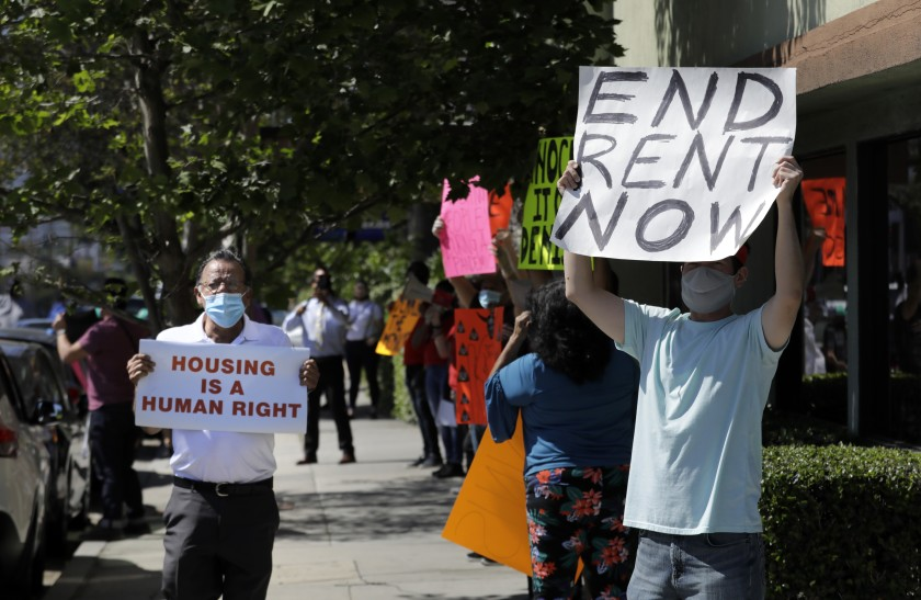 A housing rights and anti-eviction protest in Valley Village in May. The Legislature on Monday sent the governor a bill that extends protections against evictions until Jan. 31, 2021 as long as tenants pay at least 25% of their rent. (Myung J. Chun / Los Angeles Times)