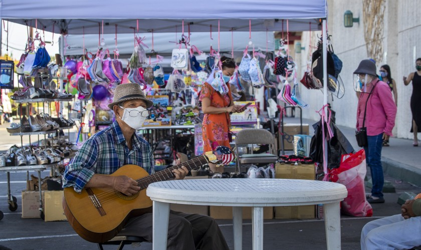 Keith Tran of Santa Ana plays guitar at the Asian Garden Mall in Westminster in this undated photo. (Allen J. Schaben / Los Angeles Times)