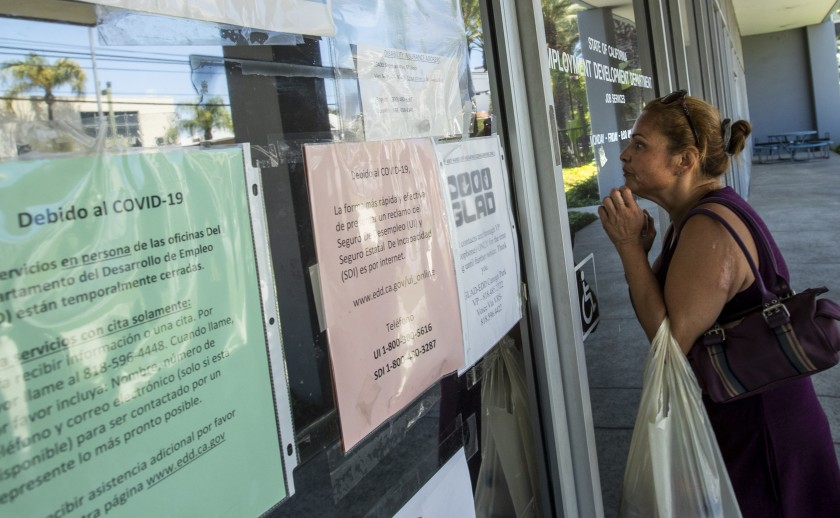 Brenda Bermudez came looking for information about her unemployment claim in May 2020 but found the California Employment Development Department office in Canoga Park closed. (Brian van der Brug / Los Angeles Times)