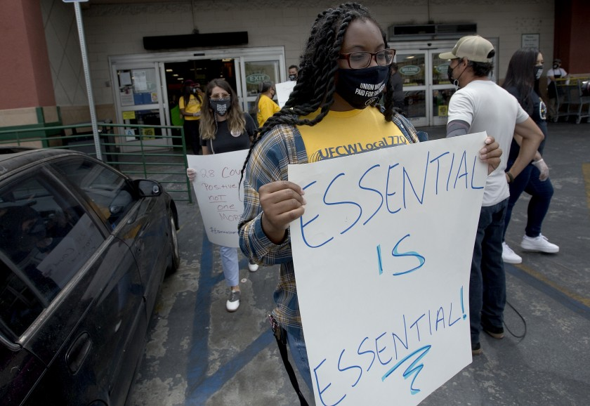 Grocery workers demonstrate outside a Food 4 Less store in Los Angeles where multiple COVID-19 cases have been reported in July 2020. (Luis Sinco / Los Angeles Times)