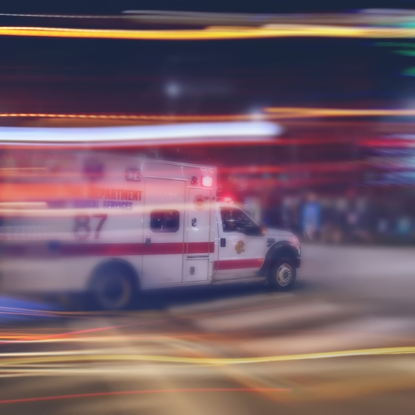 An ambulance speeds through traffic in a file image. (Credit: iStock / Getty Images Plus)