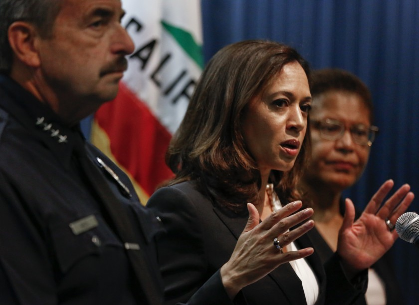 Kamala Harris, then California attorney general, appears alongside Rep. Karen Bass, right, at a news conference in this undated file photo. (Los Angeles Times)
