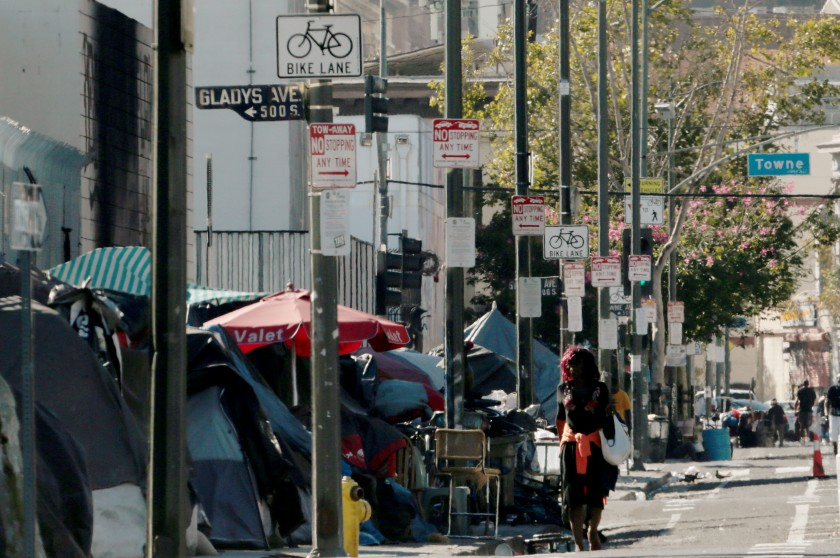 Homeless encampments line the sidewalk along Fifth Street in downtown Los Angeles on Aug. 11, 2020. (Luis Sinco/Los Angeles Times)