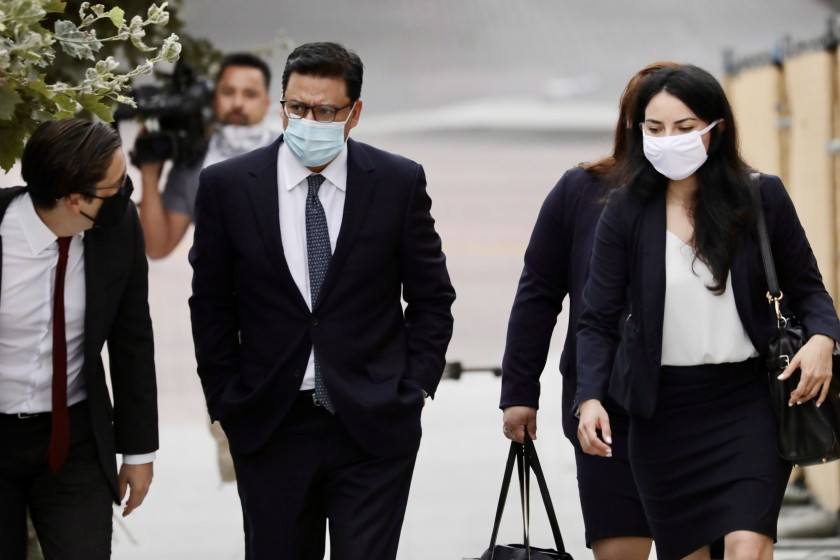 Los Angeles City Councilman Jose Huizar, center, arrives Wednesday at the federal courthouse in downtown Los Angeles. (Irfan Khan / Los Angeles Times)
