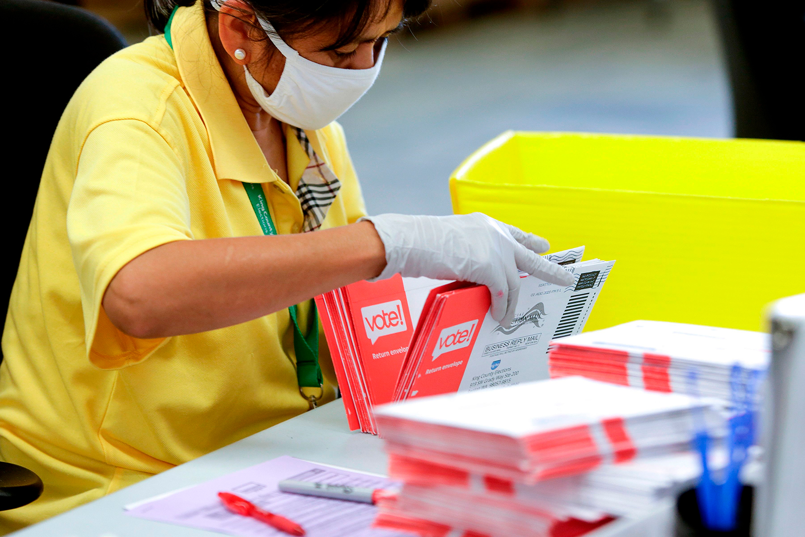 An election worker opens envelopes containing vote-by-mail ballots for the August 4 Washington state primary at King County Elections in Renton, Washington on August 3, 2020. (Jason Redman/AFP/Getty Images via CNN Wire)