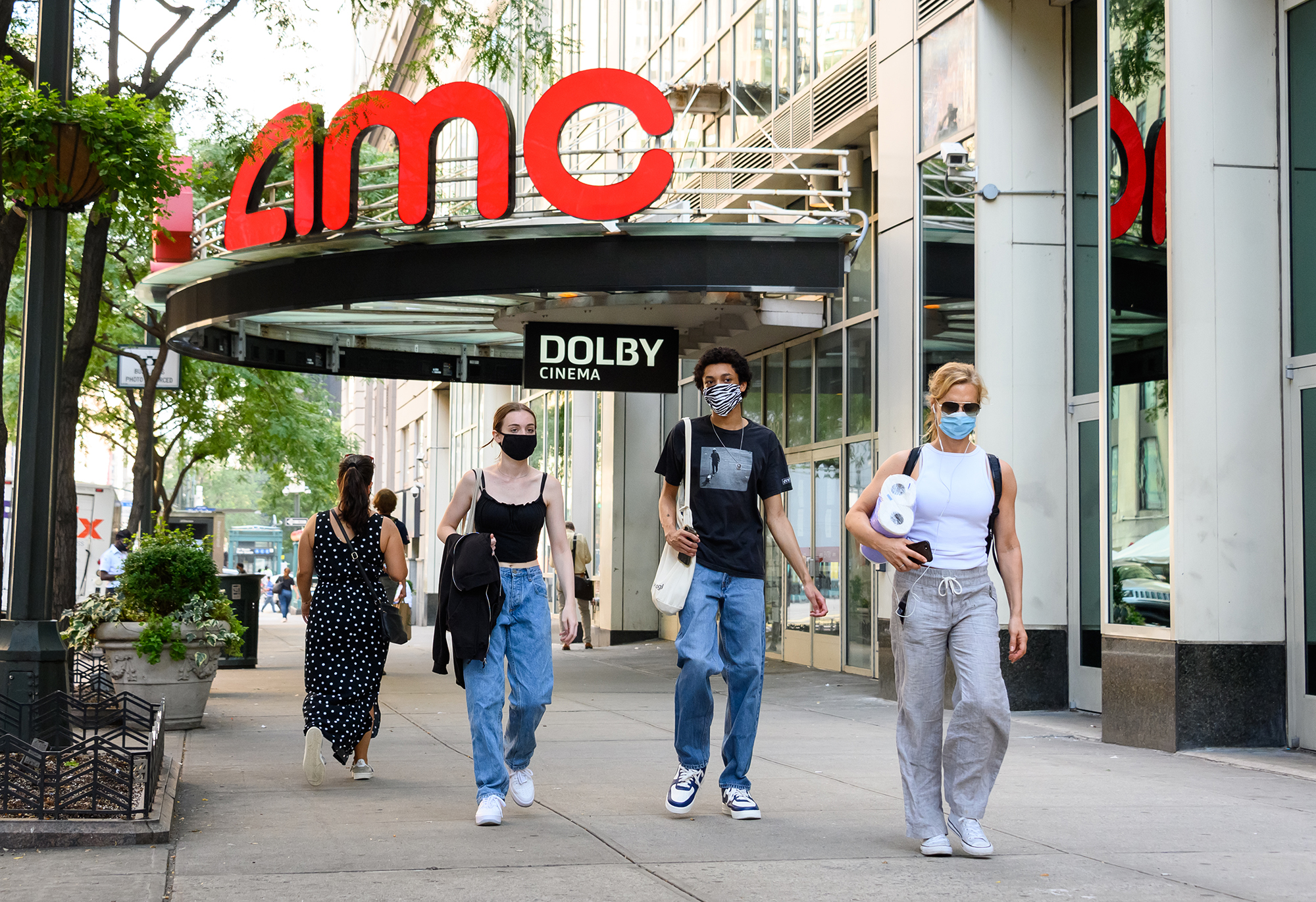 People wear protective face masks outside the AMC 34th Street 14 movie theater as the city continues Phase 4 of re-opening following restrictions imposed to slow the spread of coronavirus on July 31, 2020 in New York City. (Noam Galai/Getty Images)