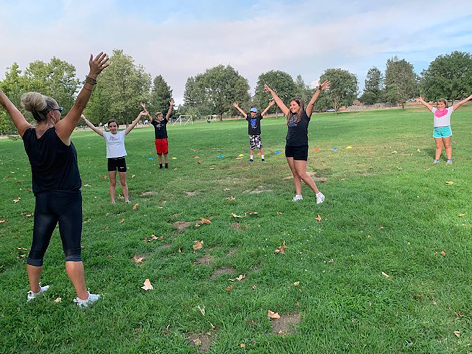 Fitness trainer Myriah Volk of Sebastopol, California, leads a socially distanced gym class through her PE Express 101 business. (Jenny Pellini via CNN)