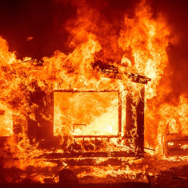 A mobile home and car burn at Spanish Flat Mobile Villa as the LNU Lightning Complex fires tear through unincorporated Napa County, California. (Noah Berger/AP via CNN Wire)