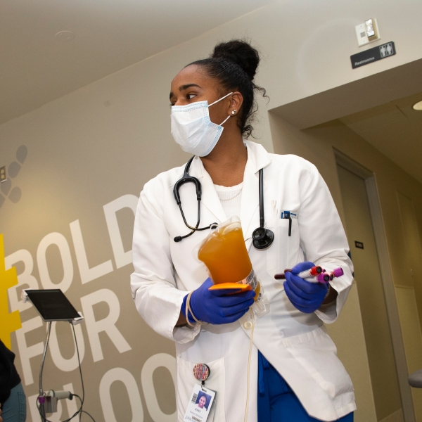 Phlebotomist Jenee Wilson carries COVID-19 convalescent plasma from a donor at Bloodworks Northwest on April 17, 2020, in Seattle, Washington. (Karen Ducey/Getty Images via CNN)